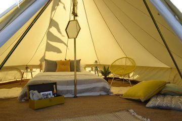 Double bed inside a bell tent for a wedding