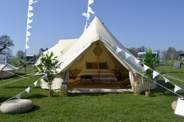 Glamping at a wedding, front view of a bell tent