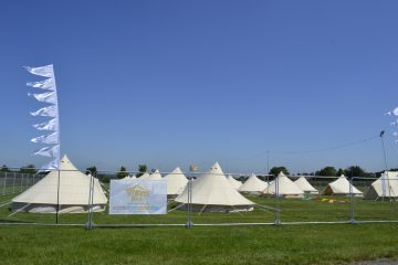 Bell Tents inside fencing for a festival event