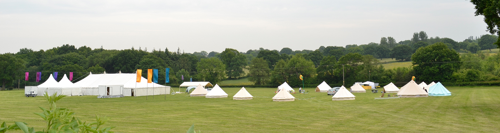 Group of bell tents set up for an event