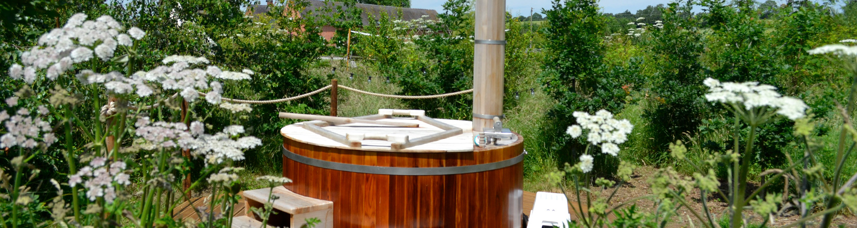 Hot Tub surrounded by flowers for a Hen Camp at The Grange