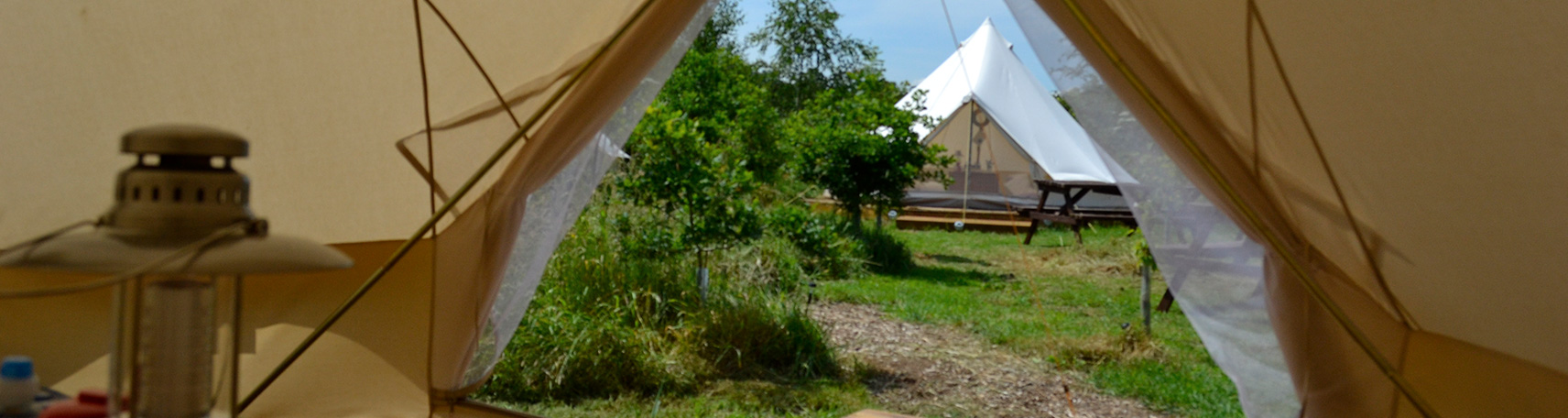 Inside out view of a Bell Tent at a Hen Camp