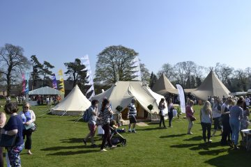 Friends and family at an event with bell tents