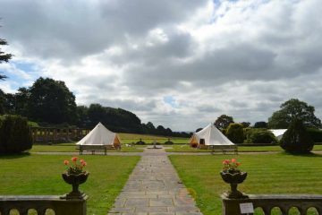 Bell Tents in an open field for family and friends
