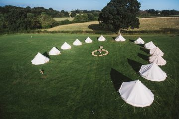 Large group of bell tents for family and friend gatherings