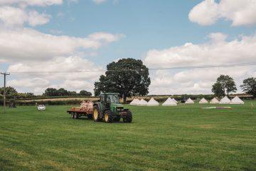 Mapperley Farm bell tents near a tractor on a field
