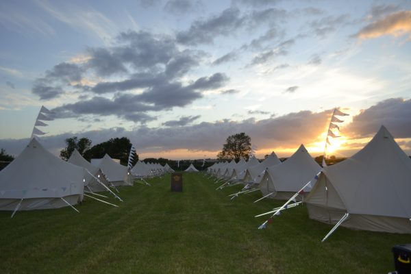 Bell Tents in the sunset inline for friends and family at a wedding