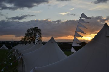 Bell tents being used at a festival