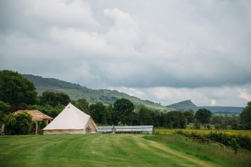 Bell Tent in open field with grey skies in the countryside