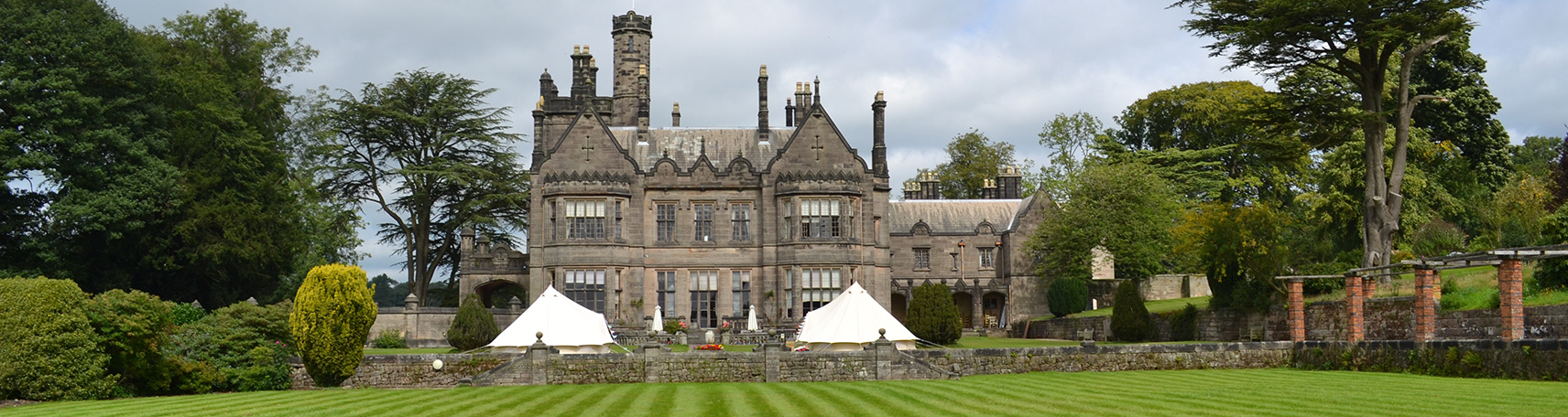 Large castle with bell tents for a bell tent wedding