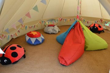 Bean bags inside a bell tent for added comfort