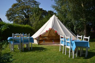Bell Tent next to table and chairs for a kids party