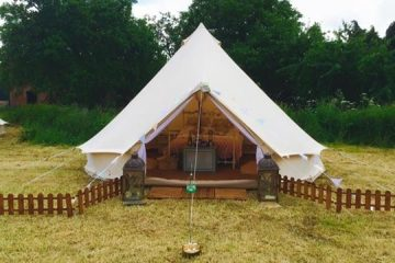 Front view of a Bell tent with picket fencing