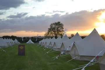 Bell tents for glamping at a festival with family and friends